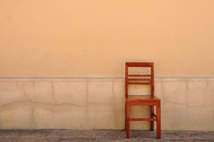 Free wood chair with the old wall, classic chair Royalty Free Stock Photography