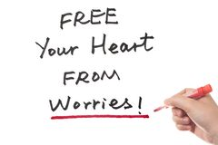 Free your heart from worries. Words written on white board Royalty Free Stock Photo