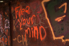 Free Your Mind. Graffiti on an old iron railroad bridge Stock Photo