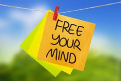 Free Your Mind. Inspirational text. Free Your Mind. Motivational inspirational quotes words. Colorful Paper with blurred background royalty free stock photography
