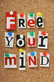 Free Your Mind. The phrase Free Your Mind in cut out magazine letters pinned to a cork notice board Royalty Free Stock Image