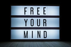 Free your mind. `Free your mind`  text in lightbox Stock Photos