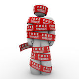 Free Yourself Tape Wrapped Around Man Fight Back. A person or man is oppressed and wrapped up in red tape reading Free Yourself to illustrate the need to fight Stock Photos