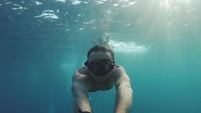 Freediver on corals in Red sea, Man swimming underwater in blue sea water, Dahab Egypt, 4k