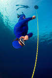Freediver. Descending along the rope. Free immersion discipline Stock Photo