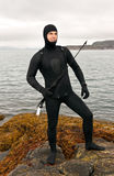Freediver in a diving suit on the Barents Sea Stock Photo