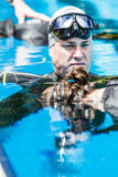 Freediver doing Static Performance with Coach a Coach Doing the Royalty Free Stock Photography