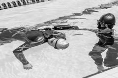 Freediver doing Static Performance with Coach a Coach Doing the Stock Photo
