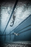 Freediver Dynamic with Monofin Performance from Underwater. MONTREAL, CIRCA JUNE 2014 - Two Hot Spring Days of Freediving Competition at Jean-Drapeau 50m Outdoor stock photography