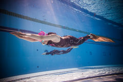 Freediver Dynamic with Monofin Performance from Underwater. MONTREAL, CIRCA JUNE 2014 - Two Hot Spring Days of Freediving Competition at Jean-Drapeau 50m Outdoor royalty free stock images