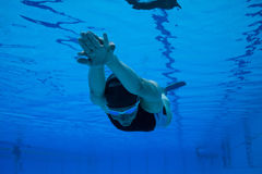 Freediver. Female freediver with monofin swimming underwater in swimming pool Royalty Free Stock Photos