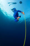 Freediver. Free diver decsending along the rope. Free immersion discipline Royalty Free Stock Photography