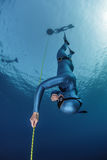 Freediver. Lady freediver descending along the rope. Free immersion discipline Royalty Free Stock Photography