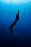 Freediver moves out of the depth Royalty Free Stock Images