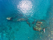 Freediver and ship wreck stock photos