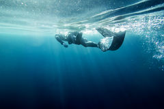 Freediver swim in the sea. Freediver in wetsuit neoprene swim in the sea Royalty Free Stock Photos