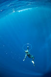 Freediver tries to swim through the air ring Stock Photography
