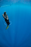 Freediver tries to swim through the air ring Royalty Free Stock Photography