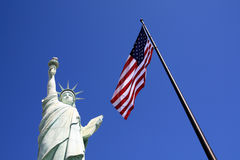 Freedom. Las Vegas - American flag and Statue of Liberty on the sky Royalty Free Stock Photos
