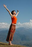 Freedom!. Joyful girl over the mountains with outstretched arms. Early in the morning Royalty Free Stock Photography