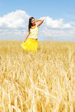Freedom. Beautiful young woman on the yellow wheat field Royalty Free Stock Photography