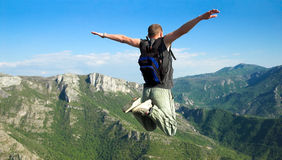 Freedom. Man makes base jump from cliff Royalty Free Stock Photo