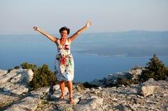 Freedom. Gesture of freedom on top of Vidova Gora on Brac island in Croatia Royalty Free Stock Photos