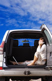 Freedom. Young girl talking on phone in the car Royalty Free Stock Images