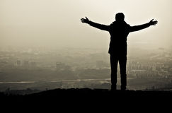 Freedom. Silhouette of a man with his arms open Royalty Free Stock Photography