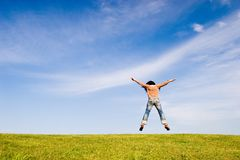 Freedom #2. Woman jumping on green field stock photos