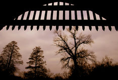 Freedom. Silhouette of medieval open gate, with trees at the background Royalty Free Stock Photos