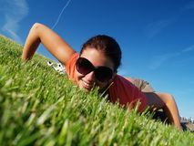 Freedom. The girl on a grass Royalty Free Stock Photography