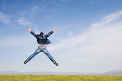 Freedom #3. Man jumping on green field royalty free stock photo
