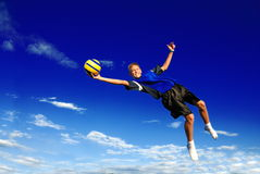 Freedom. A boy catches a ball in mid air Royalty Free Stock Photography