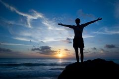 Freedom. Young man standin with arms stretched royalty free stock image