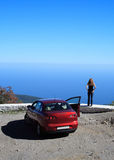 Freedom. Girl looking at the sea. Her car is near Stock Images