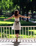 Freedom. A girl open her arms welcomes the freedom Royalty Free Stock Images