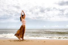 Freedom. Girl relax in the sea Stock Photos