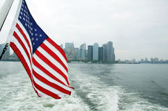 Freedom. A boat with an America Flag departing New York Royalty Free Stock Images