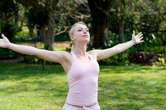 Freedom. An attractive blond girl open her arms welcomes the freedom Stock Images