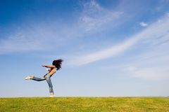 Freedom. Woman on green field stock photos