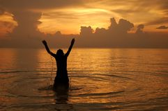 Freedom. Weaving hands out of the water during sunset, koh tao Thailand Stock Photography