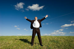 Freedom. Business man - arms outstretched Stock Photo
