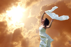 Freedom. Young nice girl on a background of the sky Stock Image