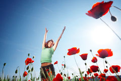 Freedom. Girl relaxing in poppy field Stock Photos