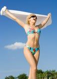 Freedom. Pretty blond in bikini screaming on the beach Stock Image