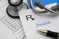 Freedom. Prescription for freedom with stethoscope and health chart Royalty Free Stock Photography