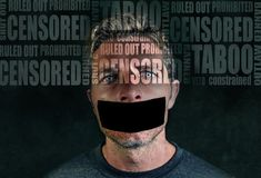 Freedom advertising composite with words like censored and taboo composed into face of young sad man with mouth sticky duct tape. Shut up isolated on grunge stock images
