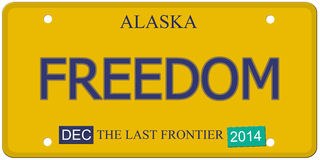 Freedom Alaska License Plate. An imitation Alaska license plate with December 2014 stickers and FREEDOM written on it making a great concept.  Words on the Royalty Free Stock Images