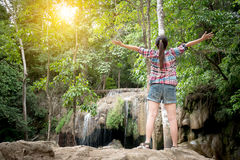 Freedom Asian traveler woman standing with raised arms and enjoy Stock Photos